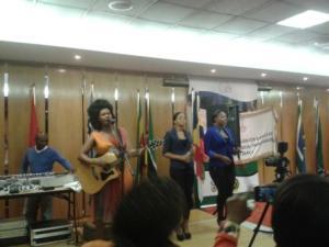 Zahara singing at flag hand over ceremony